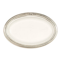Tuscan Small Oval Dish - An unusual salad plate, a catch-all for the bath, or a small dish for accents to a meal � the Tuscan Small Oval Dish lightens the color scheme and deepens the richness of texture in any application.  Made from clean white ceramic for easy matching and luxurious crispness, the elongated oval plate is surrounded in hand-finished, authentic Italian pewter, stamped and grooved for a tasteful touch of tradition in this refined accenting dish.