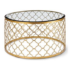"Regina Andrew - Regina Andrew Furniture Mosaic Gold Leaf Cocktail Table - Regina-Andrew Design marries vintage style with modern flair for a furniture collection that's truly timeless. A simple quatrefoil pattern and sleek gold-leaf finish lend the round Mosaic cocktail table a chic, retro style. Its open-air metal frame is finished with a beveled glass top for a beautiful accent in the living room, bedroom or den. 33""Diameter x 18""H ."