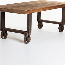 Tosca Industrial Dining Table - Love industrial style? It can be difficult to give a dining room that rugged edge, but we think this gorgeous table ought to do the trick. Heavy iron wheels make a hearty counterpoint to the thick, rustic-finished pine top.