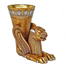 "EttansPalace - Ancient Persian Winged Lion Rhyton Vessel Urn - (c. 500 BC),Tehran Museum, Iran; We found the original so exquisite that we took the hand-held drinking vessel or ""rhyton"" once found on the table of 5th-century Achaemanian kings and upsized it into this dramatic urn. The commanding lion, a royal motif from the early Mesopotamian era, is embellished with the powerful wings so revered in ancient Persian culture. Our antique replica is cast in quality designer resin and finished in faux gold with silver accents to become a singularly stunning focal point as art alone or with a grand floral display. Another quality antique replica statue."
