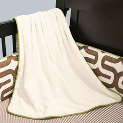 Soho Collection - Enjoy this warm and snuggly baby blanket in Cuddle Ivory accented with Leaf Twill cording . Natural flannel on back.