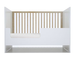 Spot on Square - Oliv Crib Conversion - The Spot on Square Oliv Crib Conversion converts your Oliv Crib to a stylish daybed, extending the life of your crib as your child grows. Easily converts by removing one crib side panel and replacing with the conversion panel.