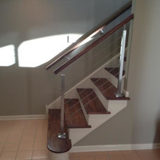 Beach Style Staircase by Andrew Robbins Fine Custom Homes, Inc.