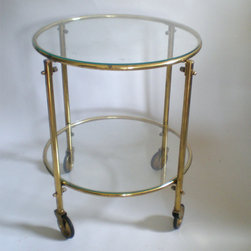 Circular Brass Table/Cart by Green Zebre Home - This brass and glass table would make the perfect bar cart in a small space. Style your liquor bottles below and your glassware on top to be party-ready in minutes.