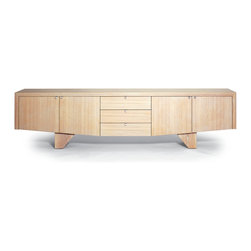 Sea Chest Sidecase - A modern form with a driftwood feel. Four cabinet bays and three drawers provide generous storage space for living or dining. The Sea Chest sidecase is designed by Sherwood Hamill, co-founder of angela adams, and is handcrafted in Portland, Maine. Shown here in Sand.