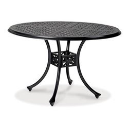 Thos. Baker - hedges round dining table - Our hand-cast aluminum hedges collection recreates the look of classic English cast iron without the weight. Black powder-coated enamel provides a rust-free, UV-resistant finish that is extremely durable. Chair and sofa backs feature a Union Jack criss-cross motif with a center medallion.  This British flag pattern is repeated in all the table tops.