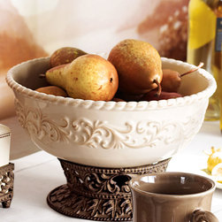 "GG Collection - Serving Bowl - LATTE - GG CollectionServing BowlDetailsEXCLUSIVELY OURS.Handcrafted of ceramic and metal.Ceramic bowl detaches from metal stand; bowl is dishwasher safe. 11.5""Dia.Imported.Designer About GG Collection:GG Collection is the brainchild of two friends Dixie Harrigan and Leigh Anne Baysinger who wanted to make accessories for those who prefer classical decor to modern influences. Together they started a movement for the revival of the classic European style beginning with Tuscan-inspired canisters and spice jars then expanding to include dinnerware and other decor. Their creative combination of metal stoneware and mouth-blown glass achieves the relaxed European-country style they were striving to create."