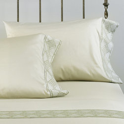 "Frontgate - Isola Pillowcase - 100% cotton sateen woven in Italy. 600-thread count. Choose from several calming colors. Machine Washable. Standard: 20"" x 27"" +5"" overhang. King: 21"" x 37"" +5"" overhang.. Inspired by the emerald vegetation and sprawling castles of its namesake, our Isola Sateen Bedding Collection from Eastern Accents translates the best of tropical serenity to home decor. Lush palm leaves layer a rattan border to create a casual, elegant look with distinctive dimensional appeal. Isola's signature color, yarn-dyed Aloe, fosters a tranquility that enhances this collection's idyllic undertones.  .  .  .  . . Because this bedding is specially made to order, please allow 4-6 weeks for delivery.. Fabrics woven in Italy; sewn in the U.S.A. Part of the Isola Sateen Bedding Collection."