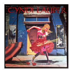 """Glittered Cyndi Lauper Album Shes So Unusual - Glittered record album. Album is framed in a black 12x12"""" square frame with front and back cover and clips holding the record in place on the back. Album covers are original vintage covers."""