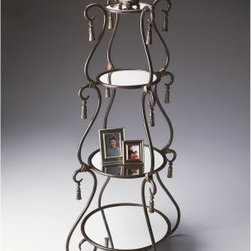Butler Metalworks Pewter Scroll 4 Shelf Mirrored Etagere - The Butler Metalworks Pewter Scroll 4 Shelf Mirrored Etagere is an ornate addition to your home. This classic piece's mirrored shelves are surrounded by flourishing designs and will certainly add its own flair to any room.The different sizes of shelves allow for the display of all sorts of items. The mirrors brighten up any space and act as a natural foil to your photos, knick knacks, and whatever else you display here.This classic design melded with mirrored shelves is certainly a bright idea.About Butler SpecialtyButler Specialty Company has been designing and manufacturing high-quality occasional and accent furniture since 1930. Each piece reflects Butler's dedication to enduring design, exquisite craftsmanship, and top-quality materials. This family-owned company is based in Chicago. They scour the globe in search of the finest materials and most efficient means of production, reflecting their commitment to providing excellent quality at exceptional value.