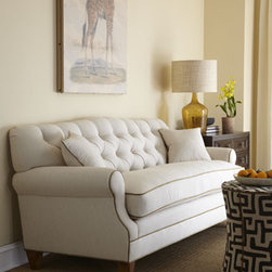"""Key City Furniture - Key City Furniture """"Ricci"""" Tufted-Back Sofa - A tufted back and contrasting trim make this ivory sofa a standout in any room. Handcrafted of select hardwoods with a cotton/linen-blend upholstery. Wooden legs have a """"brandy"""" finish. Springs, fiber padding, batting, and non-woven parts made from...."""