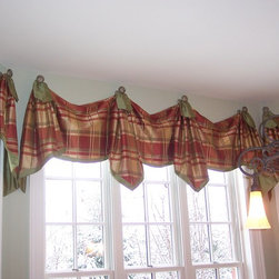 Elegant Estate -- Kitchen Bay Window - Simple valances made elegant with the use of silk plaid and green silk trim and embellishments. The custom-designed window treatment hangs from rosette, nickel hardware.