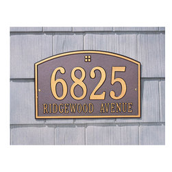 Cape Charles Address Plaque - Make your mark with this slightly domed address plaque. Tall numbers make it easy to read from the road or sidewalk. Appropriate for home or residential use, this plaque has coordinated trim and a simple design. Your choice of one or two lines of personalization.