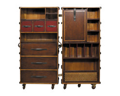 """Inviting Home - Armoire Trunk (black) - Custom made trunk armoire in antique black finish with solid brass hardware; 19-3/4"""" x 23-3/4"""" x 51-3/8""""H; This beautiful trunk-armoire is fun decorative and practical. Wood trunk is custom made finished in distressed antique black and has a solid brass hardware. Trunk features bridle leather handles and straps locks with keys. Armoire-trunk has seven wood and rubber wheels of which four will lock. This trunk-armoire features a multitude of shelves and drawers to store and display. Hand-sewn bridle leather straps and brass hardware support a foldout shelf for use as workspace. It opens to a removable inset shelf-unit with a removable mirror stored in the back. The rattan compartment underneath will hold laundry and shoes. Early 19th C. French Louis Vuitton and Goyard trunk and luggage workshops exported to the traveling upper classes of the world. As trunk-making techniques became more advanced these makers produced virtuoso examples of the French styles. Complete traveling closets were made to accommodate the elaborate dresses suits and uniforms of the Belle Epoque. Collection of nostalgic but highly practical trunk reproductions inspired by originals from the turn of the century."""