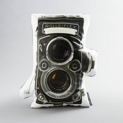 Rollei Pillow - Vintage fiends and photography buffs will love the cotton sateen Rollei Pillow. Featuring the image and shape of a vintage Rolleiflex camera, the pillow takes couch art to a whole new level.