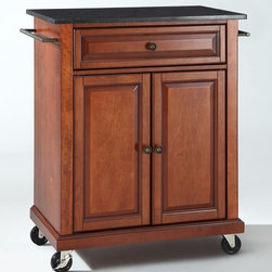 Crosley Furniture - Solid Black Granite Top Portable Kitchen Cart - 1 Adjustable shelf. 1 Drawer. 2 Beautiful raised panel doors. 2 Towel Bars. 2 Heavy duty locking casters for stability. Solid Black Granite top. Solid hardwood and veneer construction. Hand rubbed multi-step finish and White finish. Antique Brass hardware. Assembly required. 1-Year manufacturer's warranty. 28.25 in. L x 18 in. W x 36 in. H (135.3 lbs.)