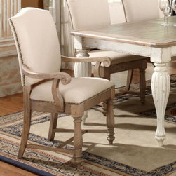 Riverside Coventry Arm Dining Chairs - Set of 2 - A weathered driftwood finish, white 100% linen upholstery, and decorative nail head trim combine to give the Riverside Coventry Arm Dining Chairs - Set of 2 a gorgeous country style. These chairs are built from hackberry hardwood solids, and have turned front legs and curved arms to add to their classic appeal. Add a Coventry dining table (sold separately) to completely make over your dining room.About Riverside FurnitureRiverside has been growing for more than half a century. The company's founder, Herman Udouj, opened the doors to his first factory in 1946, and along with 12 employees, he began making handcrafted furniture for the post-World War II Baby Boom era. Since then, generations of customers have furnished their homes and offices with Riverside's wide range of furniture products. Riverside strives to be trusted for quality products that are an affordable value. It's just that simple.Notes on Riverside ConstructionAll Riverside domestic furniture is constructed of fine oak, ash, poplar, and pine wood. These wood types are durable and feature beautiful, open grains that make them much preferred among furniture manufacturers. Each piece of wood is first graded for quality, then kiln-dried to remove excess moisture and prevent splitting. The wood is then constructed into a high-quality furniture piece using a combination of hardwood solids and hand-selected veneers. Techniques used on Riverside pieces include dovetail joinery, heavy-duty drawer roller guides, and multi-step finish applications that include hand-sanding and polishing for a deep, lustrous result. All Riverside furniture is given this high-quality treatment to ensure the beauty and durability of your final product.