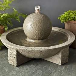 Campania Cast Stone Sphere Garden Terrace Outdoor Fountain - The Campania Cast Stone Sphere Garden Terrace Fountain makes it simple to add interest to your garden or create a calming oasis right in your backyard. This classic spherical fountain design provides the ambient sound of running water for a soothing counterpoint to the noise of a busy day. Made of high quality cast stone, this piece is durable and will weather the test of time as it ages naturally. Each piece will change and evolve to become timelessly unique. The Sphere Garden Terrace Fountain is available in the following finishes: natural, antique bronze, aged limestone, alpine stone, brownstone, copper bronze, chandoline, English moss, greenstone, lead antique, travertine, and verde.About Campania InternationalEstablished in 1984, Campania International's reputation has been built on quality original products and service. Originally selling terra cotta planters, Campania soon began to research and develop the design and manufacture of cast stone garden planters and ornaments. Campania is also an importer and wholesaler of garden products, including polyethylene, terra cotta, glazed pottery, cast iron, and fiberglass planters as well as classic garden structures, fountains, and cast resin statuary.Campania Cast Stone: The ProcessThe creation of Campania's cast stone pieces begins and ends by hand. From the creation of an original design, making of a mold, pouring the cast stone, application of the patina to the final packing of an order, the process is both technical and artistic. As many as 30 pairs of hands are involved in the creation of each Campania piece in a labor intensive 15 step process.The process begins either with the creation of an original copyrighted design by Campania's artisans or an antique original. Antique originals will often require some restoration work, which is also done in-house by expert craftsmen. Campania's mold making department will then begin a multi-step process to create a production mold which will properly replicate the detail and texture of the original piece. Depending on its size and complexity, a mold can take as long as three months to complete. Campania creates in excess of 700 molds per year.After a mold is completed, it is moved to the production area where a team individually hand pours the liquid cast stone mixture into the mold and employs special techniques to remove air bubbles. Campania carefully monitors the PSI of every piece. PSI (pounds per square inch) measures the strength of every piece to ensure durability. The PSI of Campania pieces is currently engineered at approximately 7500 for optimum strength. Each piece is air-dried and then de-molded by hand. After an internal quality check, pieces are sent to a finishing department where seams are ground and any air holes caused by the pouring process are filled and smoothed. Pieces are then placed on a pallet for stocking in the warehouse.All Campania pieces are produced and stocked in natural cast stone. When a customer's order is placed, pieces are pulled and unless a piece is requested in natural cast stone, it is finished in a unique patinas. All patinas are applied by hand in a multi-step process; some patinas require three separate color applications. A finisher's skill in applying the patina and wiping away any excess to highlight detail requires not only technical skill, but also true artistic sensibility. Every Campania piece becomes a unique and original work of garden art as a result.After the patina is dry, the piece is then quality inspected. All pieces of a customer's order are batched and checked for completeness. A two-person packing team will then pack the order by hand into gaylord boxes on pallets. The packing material used is excelsior, a natural wood product that has no chemical additives and may be recycled as display material, repacking customer orders, mulch,or even bedding for animals. This exhaustive process ensures that Campania will remain a popular and beloved choice when it comes to garden decor.Please note this product does not ship to Pennsylvania.