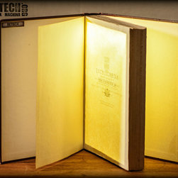 book lights - Discarded books that have been hollowed out and turned into lights. Turn them on by standing up, turn them off by laying down.