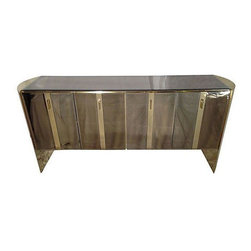 Pre-owned Mirrored Credenza Attributed to Ello - An ultra glam mirrored credenza, attributed to Ello. This classic design will incorporate well with any modern decor. The entire piece is a series of cabinets, perfect for any storage needs. Minor blemishes that give it a seasoned look.