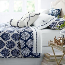 Garnet Hill - Garnet Hill Ikat Medallion Reversible Quilt - Twin - Royal Navy Blue - Tribal-inspired prints are trending - instantly refresh the room with stylized ikat on a fun reversible quilt and sham of cotton sateen. White-ground print reverses to colored ground for two looks in one. Quilt has slightly rounded corners and a lightweight cotton flannel fill. Sham has concealed side-zipper closures for a reversible design. Diamond-pattern quilting.