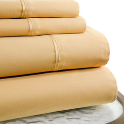 Trade Linker International lnc. - Gold 600-Thread Count Supima Cotton Sheet Set - Woven from supima cotton in an extra long staple, this 600-thread count sheet set offers extreme comfort and superior durability. �� Includes flat sheet, fitted sheet and two pillowcases Fits mattresses up to 18'' deep 100% supima cotton 600-thread count Machine wash cold; tumble dry low Imported