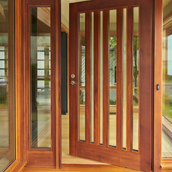 "CUSTOM FRONT DOORS - We often design custom front doors for our projects, using mostly wood and glass (both clear and satin etch).  The front door is the first ""handshake"" between the house and a visitor, and we strive to create a highly crafted, modern door that reveals the design approach for the house."