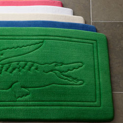 "Lacoste - Lacoste Bath Rug, 21"" x 34"" - An imprint of the legendary Lacoste crocodile is at the center of this bath rug with memory foam cushioning for plush comfort underfoot. Polyester with cotton trim. Select from an array of bold, preppy colors when ordering. Approximately 21"" x 34"". ...."