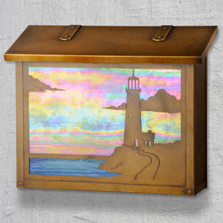 Lighthouse Large Wall Mounted Mailbox - A lighthouse is a classic symbol of safety and strength and a perfect design element for your Coastal Cottage mailbox from America's Finest. Select one of our many hand applied patina finishes and complete the design with a beautiful piece of art glass to create the sky and blue water. Handmade of solid brass this large design of this mailbox is perfect for mounting in a more open space. It has a traditional hinge detail on the lid and a rubber bumper inside to eliminate any noise when closing. The corner rivets complete the design and give this mailbox it's rugged handcrafted look. Easy to mount and a wonderful addition to your front entry this Lighthouse mailbox design will be a delight for years to come. As with all America's Finest products it carries our lifetime warranty.
