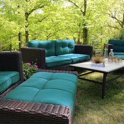 Wright Outdoor Deep Seating - Should the classic lines of mid century modern design be restricted to just inside? We think not. The Wright collection showcases the stylings of the mid 50s in its clean lines and tapered legs. The sofa, chairs, and ottomans all have tuxedo pleated tufted Sunbrella cushions… not something you'll find in every day patio furniture. So harken back to the atomic age and enjoy this smooth, fast collection.