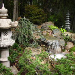 AguaFina Gardens International - Japanese Lanterns - Hand carved by stone artisans that pass their craft down through the generations, these traditional Japanese lanterns are a natural addition to a water garden and add Asian flair to any garden.