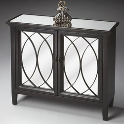 Butler - Butler Console Cabinet - Plum Black - 4113136 - Shop for Buffets and Side Boards from Hayneedle.com! The Butler Console Cabinet - Plum Black is an ode to contrast that is a sure fit for any home. Made primarily from hardwood solids (and other wood products) this contemporary console cabinet features a plum black finish to its frame and a decorative grillwork design. A mirrored top and front offers a stark counterpoint to the dark finish while the piece's shallow design makes it great from hallways entryways and other transitional areas. A two-door storage compartment is included in the design (with an adjustable shelf). Piece requires no assembly and arrives ready to display.About Butler SpecialtyButler Specialty Company has been designing and manufacturing high-quality occasional and accent furniture since 1930. Each piece reflects Butler's dedication to enduring design exquisite craftsmanship and top-quality materials. This family-owned company is based in Chicago. They scour the globe in search of the finest materials and most efficient means of production reflecting their commitment to providing excellent quality at exceptional value.