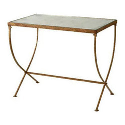 Kensington Table - Straying from the typical bar cart, an antiqued gold finish table is a stunning alternative. The mirrored top reflects accessories and drinks, giving a bar area an extra sparkle.