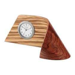 Rustic Zebrawood  Handmade Clock - Set of 4 - This desk clock defies the very nature of hardwood with its sinuous design: a sleek ribbon of richly-striped, laminated zebrawood displays the clock face, wrapping around itself to flow seamlessly into a stand. Woodworking brothers John and Mark Schlabaugh have created a handmade, modern design with organic materials that will complement the decor of any desk or shelf. Handmade in the USA.