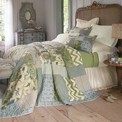 Emily Patchwork Quilt - A contemporary take on traditional patchwork, our Emily collection is an eye-catching mélange of exclusive prints and patterns - from embroidered chevrons to vintage florals, railroad stripes to graphic swirls. Rendered in a tranquil blue and green palette, it's framed with a striped binding and reverses to the same print.