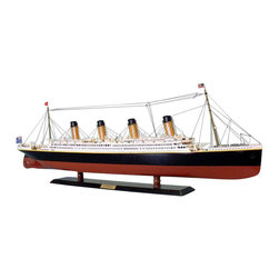 Handcrafted Nautical Decor - Remote Control RMS Titanic 40'' Limited - --REMOTE CONTROLLED VERSION--SOLD FULLY ASSEMBLED--Ready for Immediate Display - Not a Model Ship kit--Exquisite craftsmanship and demanding attention to every detail have produced a Limited Edition model of elegance and grandeur worthy of the RMS Titanic herself. Historically accurate and precision crafted in every detail, the opulence and grace of these museum-quality RMS Titanic replicas evoke the majesty of history's most famous ocean liner and the crown jewel of her age.--40'' Long x 5'' Wide x 13.5'' High (1:265 scale)----    Entirely redesigned from our original 40'' RMS      Titanic replicas--    Museum Quality features not available in other models or any kit--    --        Paint colors precisely matched       to those of the RMS Titanic--        All windows and portholes       exactly sized and positioned according to the original Titanic construction plans--        Historical design and       detailing of superstructure and hull--        Open promenade decks visible through superstructure windows--        Precise superstructure design and detailing--        Triple propeller design and       accurate anchors--        Metal trussed crane booms with       twin cables and pulleys on cargo hooks--        Lattice grating on ducts and       vents--        Finely-crafted wire       maintenance ladders ascend smokestacks--    --    --    Built from      scratch by      master artisans--    High quality      woods include      cherry, birch, maple, and rosewood--    Amazing Details, including:--    --        Lifeboats hung from launching davits--        Rigging and stay-lines on all       masts and smokestacks--        Delicate four-wire metal       railings on forecastle, aftcastle and atop superstructure--        All ladders, staircases and       handrails produced from delicate metal wire--        Clear panes in all deckhouse       windows--        Numerous deck objects and       features inc
