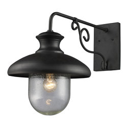 Elk Lighting - EL-62002-1 Streeside Cafe 1-Light Outdoor Sconce in Matte Black - Capture the charm of an outdoor cafe lantern. The matte black ironwork and heavy seeded blown glass achieves an authentic old world style.