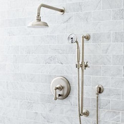 Ashland Pressure Balance Hand-Held Shower Set, Satin Nickel finish - The incredible strength of die-cast brass makes the Ashland Shower & Tub collection exceptionally durable, and keeps it beautiful after years of daily use. Each piece's graceful stepped base highlights its form, and multiple finish options allow you to create a consistent look throughout. Ashland Pressure Balance Shower & Tub Set Constructed of cast brass. Pop-up drain assembly included. Shower water flow measures 2.5 GPM. Tub water flow measures 6 GPM. Set includes double thermostatic valve, trim plate, positioning bar, handheld showerhead, tub spout and showerhead. Professional installation required. Ashland Pressure Balance Shower Set Constructed of cast brass Water flow measures 8-10 GPM. Set includes single handle pressure balance valve and trim plate, and showerhead. Finished with ceramic buttons on the stopper and each lift rod. Professional installation required. Ashland Handheld Pressure Balance Shower Set Constructed of cast brass. Pop-up drain assembly included. Set includes pressure balance valve, trim plate, positioning bar, handheld showerhead and showerhead. Shower water flow measures 2.5 GPM. Professional installation required. Ashland Handheld Thermostatic Shower & Tub Set Constructed of cast brass. Pop-up drain assembly included. Shower water flow measures 2.5 GPM. Set includes double thermostatic valve, trim plate, positioning bar, handheld showerhead, tub spout and showerhead. Professional installation required. Ashland Handheld Thermostatic Shower Set Constructed of cast brass. Pop-up drain assembly included. Set includes double thermostatic valve, trim plate, positioning bar and showerhead. Shower water flow measures 2.5 GPM. Professional installation required. View our {{link path='pages/popups/fb-bath.html' class='popup' width='480' height='300'}}Furniture Brochure{{/link}}.