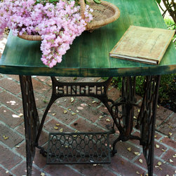 Little Furniture Lady: Antique Iron Singer Sewing Machine Table - This antique iron Singer sewing machine table is a one of a kind piece! It has a cool vintage butcher block table top that I refinished in a custom leaf green color to give it a unique and fresh contrast to the industrial iron work on the base. The surface has been mildly distressed to bring out accents of the golden wood.