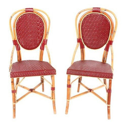 "Pre-owned French Cane Bistro Chairs - A Pair - A pair of French cane bistro chairs with plastic woven seat and back.  Weave has a few minor broken areas, but chairs are genuine and from a small Paris cafe and in useable condition. Plastic weave is missing and the cane is weathered. Seat height is 18""."