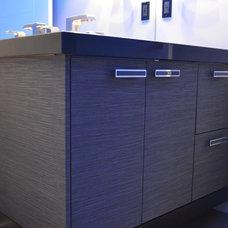 Modern Powder Room by NEXS Cabinets Inc.