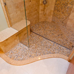 River Rock Shower with Quick Drain - Beautiful East Coast shower using river rock and Quick Drain with the Waves pattern grill. The drain can be installed anywhere in the shower pan if there is going to be a curb. Our recommendation is to locate the drain where people are not going to stand on it, where it require the least amount of work and be as much out of sight as possible.