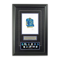 """Heritage Sports Art - Original art of the NHL 1967-68 St. Louis Blues jersey - This beautifully framed piece features an original piece of watercolor artwork glass-framed in an attractive two inch wide black resin frame with a double mat. The outer dimensions of the framed piece are approximately 17"""" wide x 24.5"""" high, although the exact size will vary according to the size of the original piece of art. At the core of the framed piece is the actual piece of original artwork as painted by the artist on textured 100% rag, water-marked watercolor paper. In many cases the original artwork has handwritten notes in pencil from the artist. Simply put, this is beautiful, one-of-a-kind artwork. The outer mat is a rich textured black acid-free mat with a decorative inset white v-groove, while the inner mat is a complimentary colored acid-free mat reflecting one of the team's primary colors. The image of this framed piece shows the mat color that we use (Medium Blue). Beneath the artwork is a silver plate with black text describing the original artwork. The text for this piece will read: This original, one-of-a-kind watercolor painting of the 1967-68 St. Louis Blues jersey is the original artwork that was used in the creation of this St. Louis Blues uniform evolution print and tens of thousands of other St. Louis Blues products that have been sold across North America. This original piece of art was painted by artist Nola McConnan for Maple Leaf Productions Ltd. Beneath the silver plate is a 3"""" x 9"""" reproduction of a well known, best-selling print that celebrates the history of the team. The print beautifully illustrates the chronological evolution of the team's uniform and shows you how the original art was used in the creation of this print. If you look closely, you will see that the print features the actual artwork being offered for sale. The piece is framed with an extremely high quality framing glass. We have used this glass style for many years with excellent results. W"""