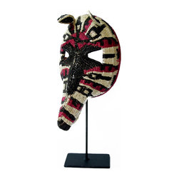 Salvatecture Studio - Enbera Tribe, Panama: Palm Fiber Anteater Mask with Stand - Own a piece of art that gives back. Handcrafted from eco-friendly materials, this distinctive anteater mask has an exotic flair that really stands out. It'll look great in your home and you'll be supporting the indigenous Enbera Tribe in Panama at the same time. Now that's cool!