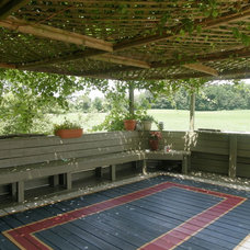 Eclectic Patio Painted area rug on deck