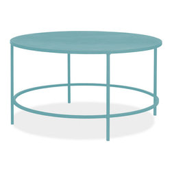 Slim Round Cocktail Table, Ocean - You can see the monochrome effect here. It's as if an ordinary table has been dipped in turquoise paint. I'm seriously considering this coffee table for my house.