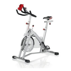"Schwinn IC2 Indoor Cycle Trainer - Console displays time distance RPM speed and calories burnt Wheels included for easy portability Handlebars adjust to accommodate multiple users Felt pads provide resistance and smooth silent workout Oversized steel tubing for workout stability and longevity Pedals easily adjust to accommodate most leg-lengths Features toe cages and """"Q"""" factor design Manufacturer's warranty included - see Product Guarantee for full details About SchwinnMore than 100 years after Ignaz Schwinn and his partner Adolph Arnold incorporated Arnold Schwinn & Company Schwinn has become an American icon. Chances are your first childhood bike was a Schwinn. The company is also a leader in home and fitness equipment and it has played a huge role in revolutionizing biking and fitness around the world."