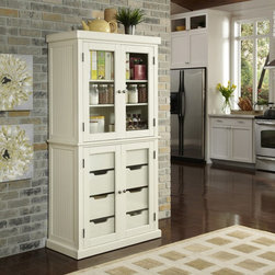 Home Styles - Home Styles Nantucket China Pantry - 5022-64 - Shop for Pantries from Hayneedle.com! The Home Styles Nantucket China Pantry gives your home a cozy inviting atmosphere in addition to a generous amount of storage space. Its sanded worn edges and distressed finish provide a casual elegance. The Nantucket China Pantry constructed of hardwood solids and engineered wood. The finishing process includes paint specking on the sanded and distressed finish for a weathered look. Brushed nickel hardware completes the look.Ample storage can be found behind the four glass doors. The top doors contain two adjustable shelves and the bottom doors contain four large storage drawers. The shelves include plate grooves to display dishes or china. Assembly required.About Home StylesHome Styles is a manufacturer and distributor of RTA (ready to assemble) furniture perfectly suited to today's lifestyles. Blending attractive design with modern functionality their furniture collections span many styles from timeless traditional to cutting-edge contemporary. The great difference between Home Styles and many other RTA furniture manufacturers is that Home Styles' pieces feature hardwood construction and quality hardware that stand up to years of use. When shopping for convenient durable items for the home look to Home Styles. You'll appreciate the value.