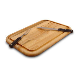 "Catskill Craftsmen - Medium Reversible Wood Cutting Board w Groove - Innovative, double sided cutting board puts plenty of convenience at your fingertips. This kitchen & cooking essential has juice grooves and trenches to keep spills off your counter. Hand applied oil finish adds long lasting protection to this hardwood board. Gourmet Collection. Made of US Hardwood from the Catskill Mountains. Oil finish. Flat grain. Reversible. Meat holding wedge area & juice groove on one side. Reverse side has wide juice catching trench. 14 in. L x 20 in. W x 1.25 in. H (7 lbs.). Made in the USAOne side has a ""holding-wedge"" that grips poultry or roasts to keep them from slipping during carving. Reverse side can be used for regular cutting and chopping needs and has a deep, wide moat to collect juices or hold garnishes."