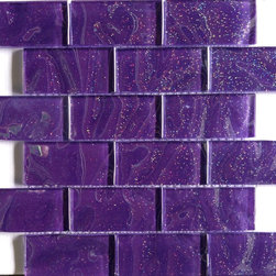 "GlassTileStore - Sparkle Elixir Glass Tile - Sparkle Elixir Glass Tile             Add a gorgeous pop of rich purple color to your ?bathroom? with our Sparkle Elixir Glass ?tile?. Ideal for a funky ?backsplash?, wall accent, pool accent, or a ?DIY? material for a weekend project! With these versatile tiles, the possibilities are endless. The mesh backing not only simplifies installation, it also allows the tiles to be separated, which adds to their design flexibility.         Chip Size: 1 3/4"" x 3 3/4""   Color: Purple with Glitter   Material: Glass   Finish: Polished   Sold by the Sheet - each sheet measures 11 1/2"" x 11 3/4"" (0.94 sq. ft.)   Thickness: 8mm            - Glass Tile -"